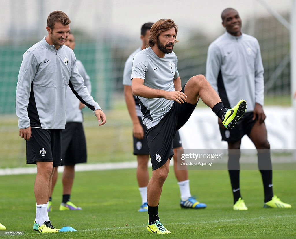 Marco Motta (L) and Andrea Pirlo (R) of Juventus during a training session on October 01, 2013 in Turin, Italy. Turkey's Galatasaray to face Italy's Juventus in the UEFA Champions League Group B match on October 2, 2013 at Juventus Stadium.