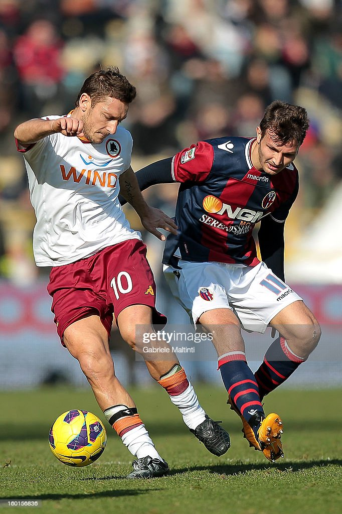 <a gi-track='captionPersonalityLinkClicked' href=/galleries/search?phrase=Marco+Motta&family=editorial&specificpeople=2443419 ng-click='$event.stopPropagation()'>Marco Motta</a> of Bologna FC fights for the ball with <a gi-track='captionPersonalityLinkClicked' href=/galleries/search?phrase=Francesco+Totti&family=editorial&specificpeople=208985 ng-click='$event.stopPropagation()'>Francesco Totti</a> (L) of AS Roma during the Serie A match between Bologna FC and AS Roma at Stadio Renato Dall'Ara on January 27, 2013 in Bologna, Italy.
