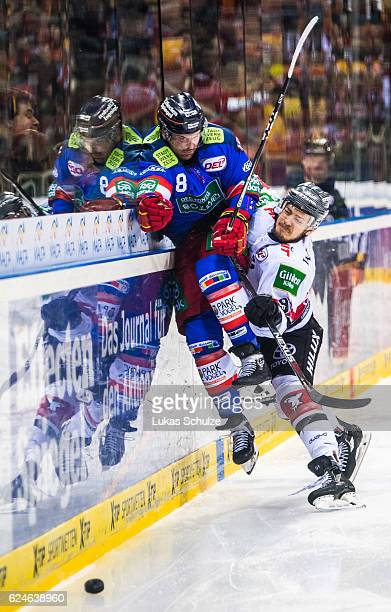Marco Nowak of Duesseldorf and Moritz Mueller of Koeln in action during the DEL match between Duesseldorfer EG and Koelner Haie at ISS Dome on...