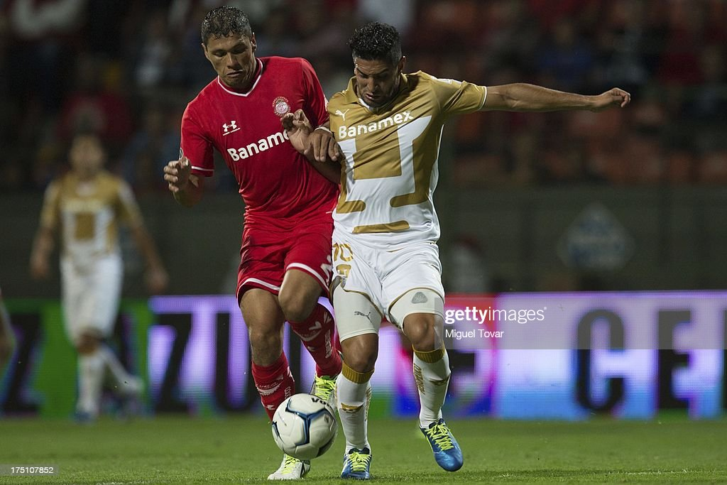 Marco Palacios of Pumas fights for the ball with Cesar Lozano of Toluca during a match between Toluca and Pumas as part of the Torneo Apertura 2013 Liga MX at Nemesio Siez stadium, on July 31, 2013 in Toluca, Mexico.