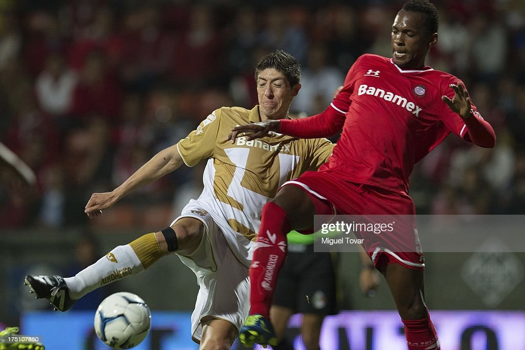 Marco Palacios of Pumas fights for the ball with Wilson Tiago of Toluca during a match between Toluca and Pumas as part of the Torneo Apertura 2013 Liga MX at Nemesio Siez stadium, on July 31, 2013 in Toluca, Mexico.