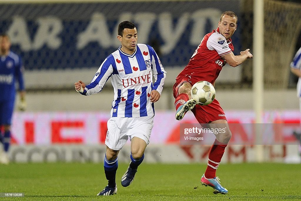 Marco Pappa of sc Heerenveen, Roy Beerens of AZ, during the Dutch Eredivisie match between sc Heerenveen and AZ Alkmaar on April 26, 2013 at the Abe Lenstra stadium in Heerenveen, The Netherlands.