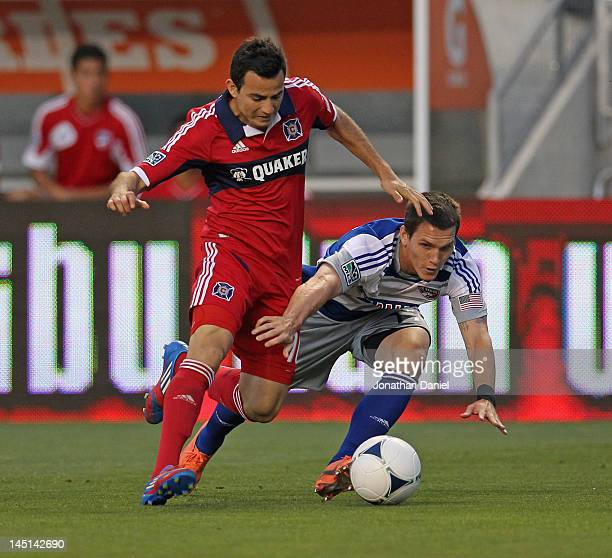 Marco Pappa of the Chicago Fire and Zach Loyd 17 of FC Dallas battle for control during an MLS match at Toyota Park on May 23 2012 in Bridgeview...