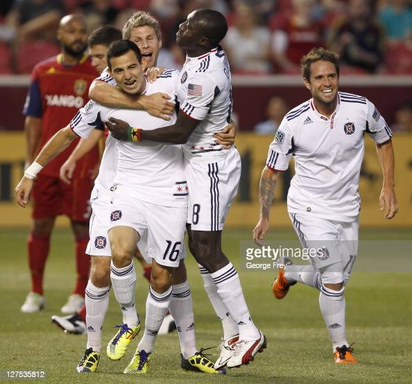 Marco Pappa of the Chicago Fire celebrates his goal with Dominic Oduro Logan Pause and Daniel PalaDini during a game against Real Salt Lake during...