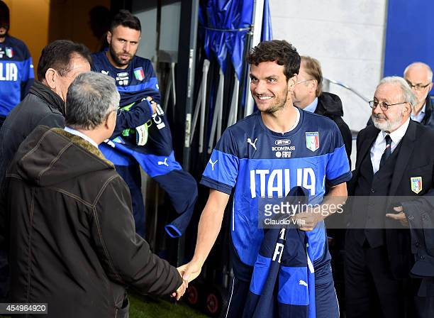 Marco Parolo of Italy and Claudio Lotito prior to the training session at Ullevaal Stadion on September 8 2014 in Oslo Norway