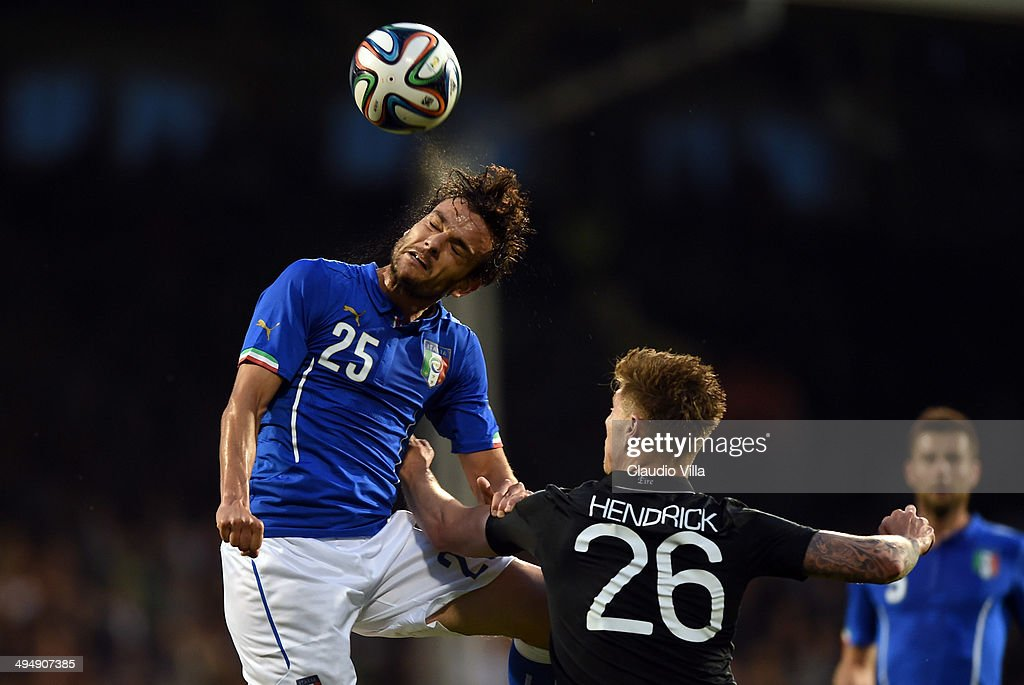 <a gi-track='captionPersonalityLinkClicked' href=/galleries/search?phrase=Marco+Parolo&family=editorial&specificpeople=6474753 ng-click='$event.stopPropagation()'>Marco Parolo</a> of Italy and Jeff Hendrick of Ireland #26 compete for the ball during the International Friendly match between Italy and Ireland at Craven Cottage on May 31, 2014 in London, England.