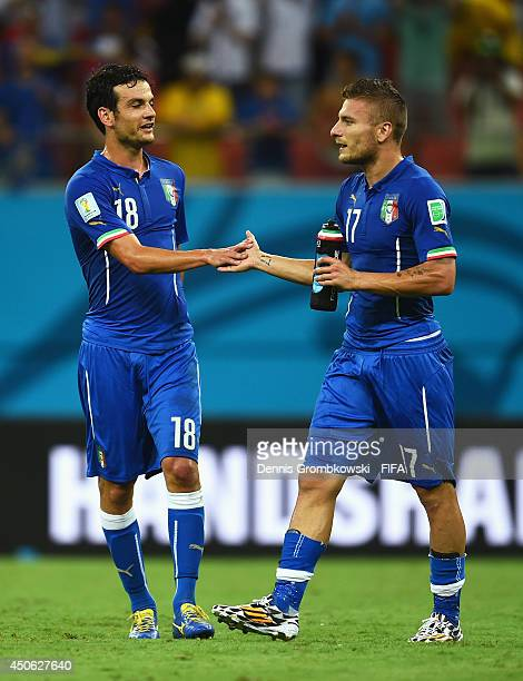 Marco Parolo of Italy celebrates with Ciro Immobile of Italy after the 2014 FIFA World Cup Brazil Group D match between England and Italy at Arena...