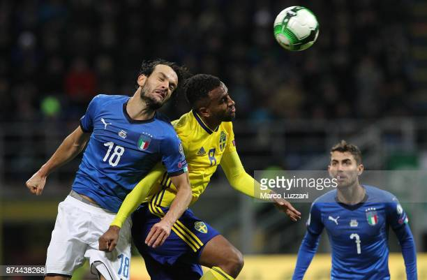 Marco Parolo of Italy competes for the ball with Isaac Kiese Thelin of Sweden during the FIFA 2018 World Cup Qualifier PlayOff Second Leg between...