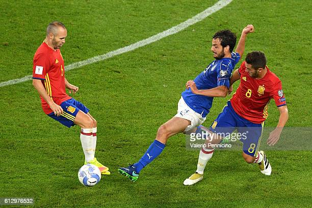 Marco Parolo of Italy fights for the ball with Andres Iniesta and Koke of Spain during the FIFA 2018 World Cup Qualifier between Italy and Spain at...