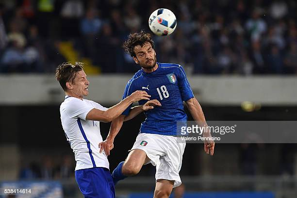 Marco Parolo of Italy goes up with Markus Halsti of Finland during the international friendly match between Italy and Finland on June 6 2016 in...