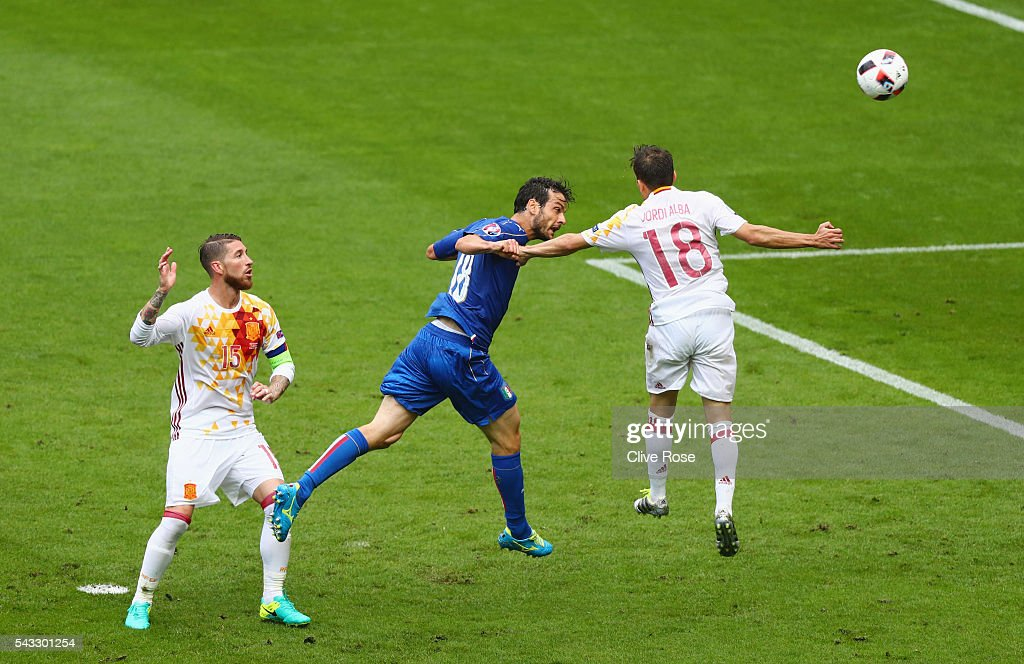 <a gi-track='captionPersonalityLinkClicked' href=/galleries/search?phrase=Marco+Parolo&family=editorial&specificpeople=6474753 ng-click='$event.stopPropagation()'>Marco Parolo</a> of Italy heads the ball during the UEFA EURO 2016 round of 16 match between Italy and Spain at Stade de France on June 27, 2016 in Paris, France.