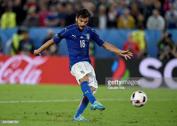 Marco Parolo of Italy scores at the penalty shootout during the UEFA EURO 2016 quarter final match between Germany and Italy at Stade Matmut...