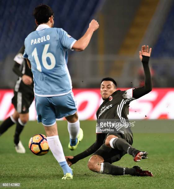 Marco Parolo of Lazio and Leonel Vangioni of AC Milan fight for the ball during the Serie A match between Lazio and Milan at Stadio Olimpico Rome...