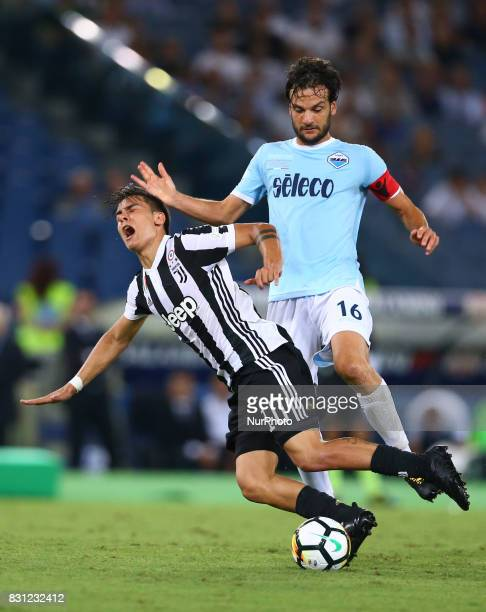 Marco Parolo of Lazio and Paulo Dybala of Juventus during the Italian Supercup match between Juventus and SS Lazio at Stadio Olimpico on August 13...