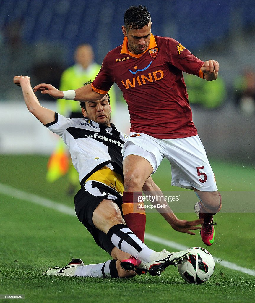 Marco Parolo of Parma and Leandro Castan of Roma in action during the Serie A match between AS Roma and Parma FC at Stadio Olimpico on March 17, 2013 in Rome, Italy.