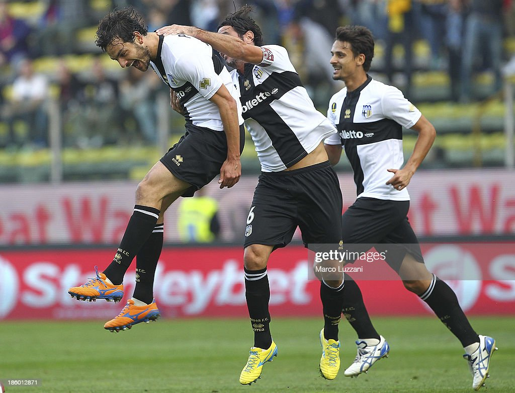 Marco Parolo of Parma FC celebrates with his teammates Alessandro Lucarelli after scoring the opening goal during the Serie A match between Parma FC...