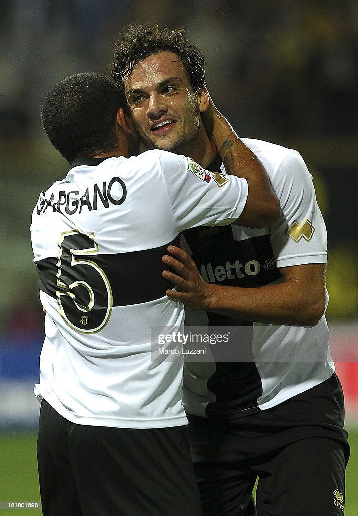 <a gi-track='captionPersonalityLinkClicked' href=/galleries/search?phrase=Marco+Parolo&family=editorial&specificpeople=6474753 ng-click='$event.stopPropagation()'>Marco Parolo</a> (R) of Parma FC celebrates with team-mate <a gi-track='captionPersonalityLinkClicked' href=/galleries/search?phrase=Walter+Gargano&family=editorial&specificpeople=3964733 ng-click='$event.stopPropagation()'>Walter Gargano</a> (L) after scoring a goal during the Serie A match between Parma FC and Atalanta BC at Stadio Ennio Tardini on September 25, 2013 in Parma, Italy.