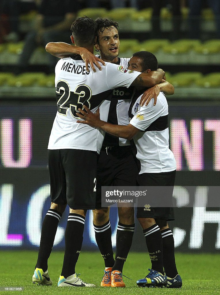 <a gi-track='captionPersonalityLinkClicked' href=/galleries/search?phrase=Marco+Parolo&family=editorial&specificpeople=6474753 ng-click='$event.stopPropagation()'>Marco Parolo</a> (C) of Parma FC celebrates with team-mates <a gi-track='captionPersonalityLinkClicked' href=/galleries/search?phrase=Walter+Gargano&family=editorial&specificpeople=3964733 ng-click='$event.stopPropagation()'>Walter Gargano</a> (R) and <a gi-track='captionPersonalityLinkClicked' href=/galleries/search?phrase=Pedro+Mendes&family=editorial&specificpeople=212915 ng-click='$event.stopPropagation()'>Pedro Mendes</a> (L) after scoring a goal during the Serie A match between Parma FC and Atalanta BC at Stadio Ennio Tardini on September 25, 2013 in Parma, Italy.