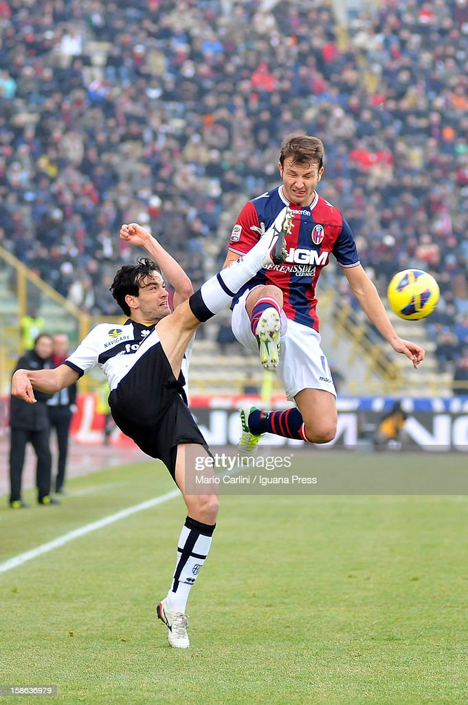 <a gi-track='captionPersonalityLinkClicked' href=/galleries/search?phrase=Marco+Parolo&family=editorial&specificpeople=6474753 ng-click='$event.stopPropagation()'>Marco Parolo</a> (L) of Parma FC competes for the ball with <a gi-track='captionPersonalityLinkClicked' href=/galleries/search?phrase=Marco+Motta&family=editorial&specificpeople=2443419 ng-click='$event.stopPropagation()'>Marco Motta</a> (R) of Bologna FC during the Serie A match between Bologna FC and Parma FC at Stadio Renato Dall'Ara on December 22, 2012 in Bologna, Italy.