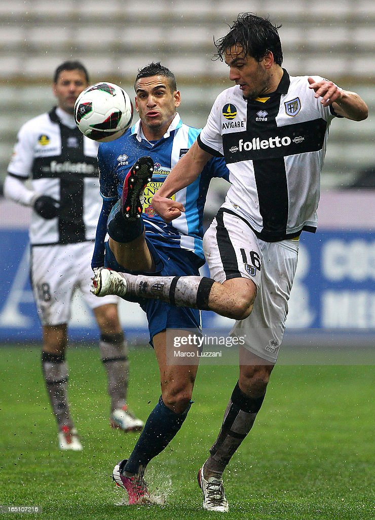<a gi-track='captionPersonalityLinkClicked' href=/galleries/search?phrase=Marco+Parolo&family=editorial&specificpeople=6474753 ng-click='$event.stopPropagation()'>Marco Parolo</a> (R) of Parma FC competes for the ball with Mervan Celik (L) of Pescara Calcio during the Serie A match between Parma FC and Pescara at Stadio Ennio Tardini on March 30, 2013 in Parma, Italy.