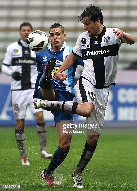 Marco Parolo of Parma FC competes for the ball with Mervan Celik of Pescara Calcio during the Serie A match between Parma FC and Pescara at Stadio...