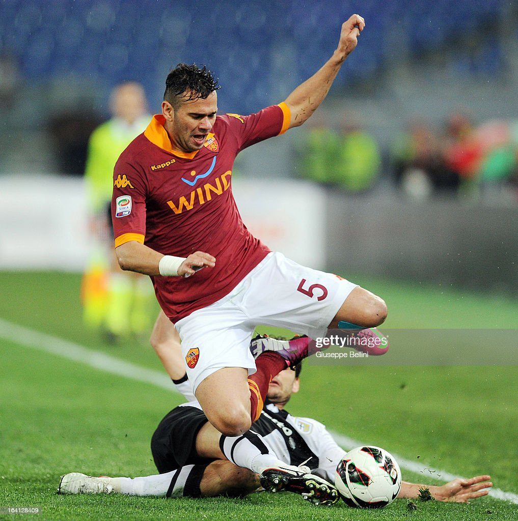 Marco Parolo of Parma tackles Leandro Castan of Roma during the Serie A match between AS Roma and Parma FC at Stadio Olimpico on March 17, 2013 in Rome, Italy.