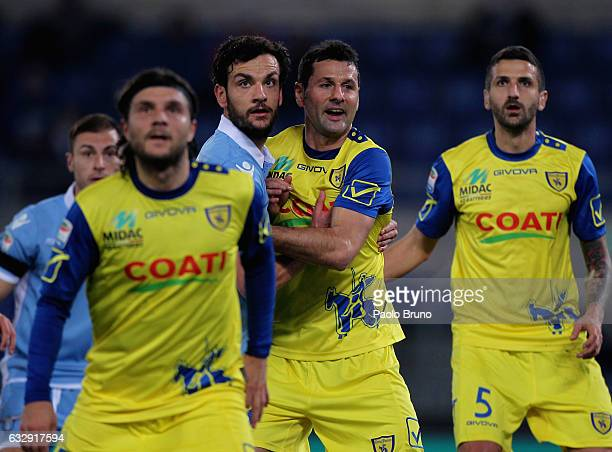 Marco Parolo of SS Lazio and Alessandro Gamberini of AC ChievoVerona in action during the Serie A match between SS Lazio and AC ChievoVerona at...