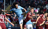 Marco Parolo of SS Lazio battles for the ball with Kamil Glik of Torino FC during the Serie A match between Torino FC and SS Lazio at Stadio Olimpico...