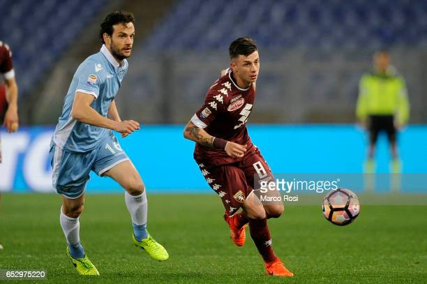 Marco Parolo of SS Lazio compete for the ball with Daniele Baselli of FC Torino during the Serie A match between SS Lazio and FC Torino at Stadio...
