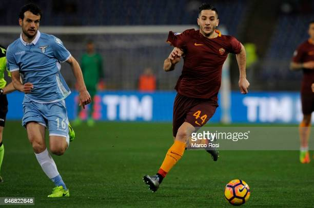 Marco Parolo of SS Lazio compete for the ball with Kostas Manolas of AS Roma during the TIM Cup match between SS Lazio and AS Roma at Olimpico...