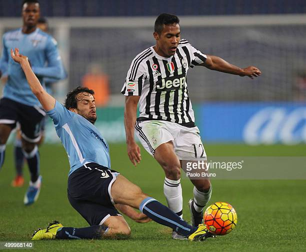 Marco Parolo of SS Lazio competes for the ball with Alex Sandro of Juventus FC during the Serie A match between SS Lazio and Juventus FC at Stadio...