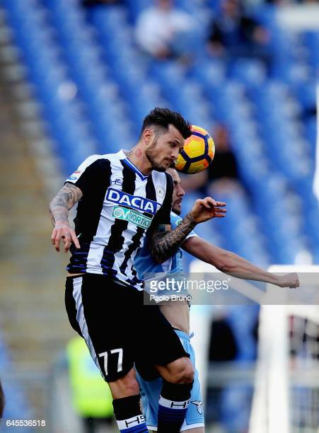 Marco Parolo of SS Lazio competes for the ball with Cyril Thereau of Udinese Calcio during the Serie A match between SS Lazio and Udinese Calcio at...