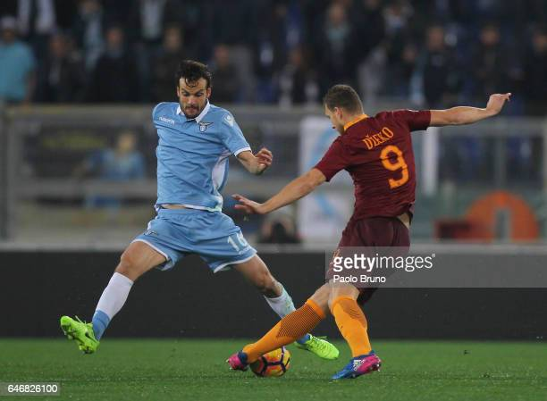 Marco Parolo of SS Lazio competes for the ball with Edin Dzeko of AS Roma during the TIM Cup match between SS Lazio and AS Roma at Olimpico Stadium...