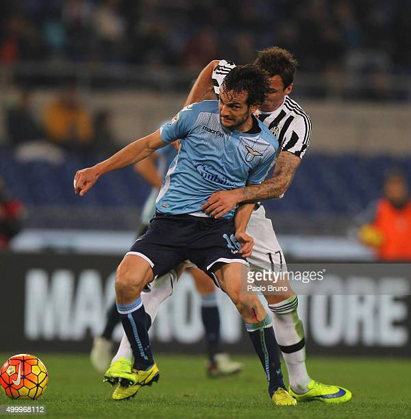 Marco Parolo of SS Lazio competes for the ball with Mario Mandzukic of Juventus FC during the Serie A match between SS Lazio and Juventus FC at...