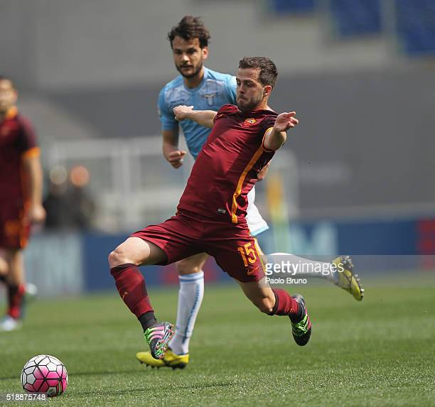 Marco Parolo of SS Lazio competes for the ball with Miralem Pjanic of AS Roma during the Serie A match between SS Lazio and AS Roma at Stadio...