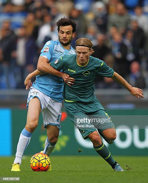 Marco Parolo of SS Lazio competes for the ball with Oscar Hiljemark of US Citta' di Palermo during the Serie A match between SS Lazio and US Citta di...