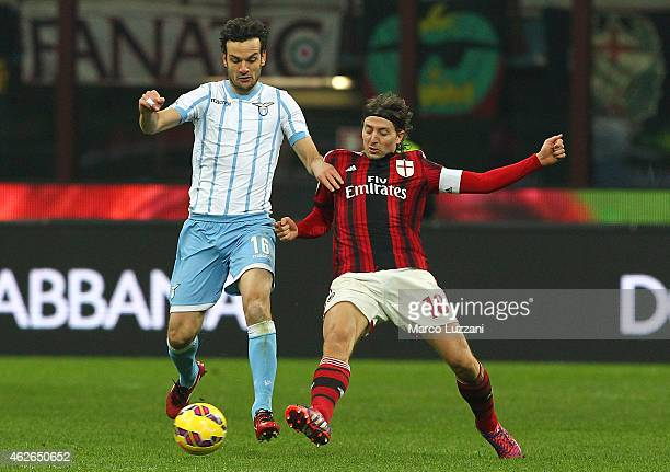 Marco Parolo of SS Lazio competes for the ball with Riccardo Montolivo of AC Milan during the TIM Cup match between AC Milan and SS Lazio at Stadio...