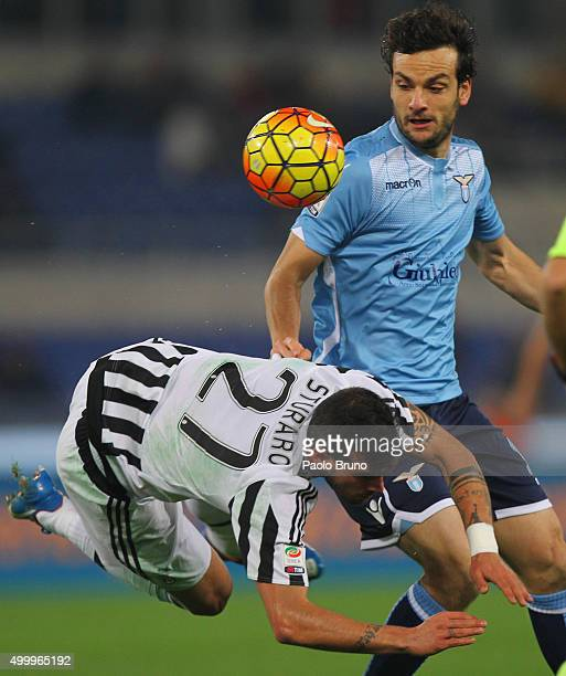 Marco Parolo of SS Lazio competes for the ball with Stefano Sturaro of Juventus FC during the Serie A match between SS Lazio and Juventus FC at...