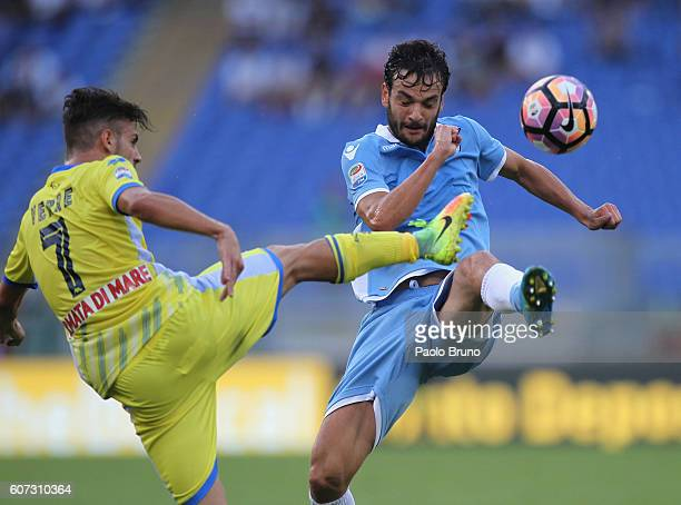 Marco Parolo of SS Lazio competes for the ball with Valerio Verre of Pescara Calcio during the Serie A match between SS Lazio and Pescara Calcio at...