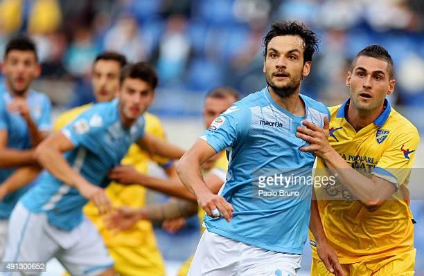 Marco Parolo of SS Lazio in action with Aleandro Rosi of Frosinone Calcio during the Serie A match between SS Lazio and Frosinone Calcio at Stadio...