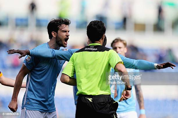 Marco Parolo of SS Lazio protest with the referee Luca Banti during the Serie A match between SS Lazio and AS Roma at Stadio Olimpico on April 3 2016...