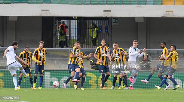 Marco Parolo of SS Lazio scores his team's second goal during the Serie A match between Hellas Verona FC and SS Lazio at Stadio Marc'Antonio...