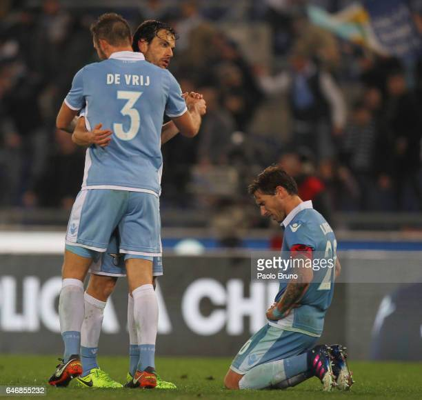 Marco Parolo Stefan De Vrij and Lucas Biglia of SS Lazio celebrate the victory after the TIM Cup match between SS Lazio and AS Roma at Olimpico...