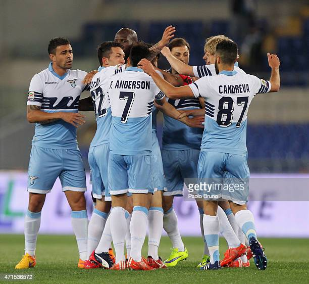 Marco Parolo with his teammates of SS Lazio celebrates after scoring the opening goal during the Serie A match between SS Lazio and Parma FC at...