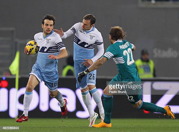 Marco Parolo with his teammates Stefan Radu and Federico Marchetti of SS Lazio celebrate after scoring the first team's goal during the Serie A match...