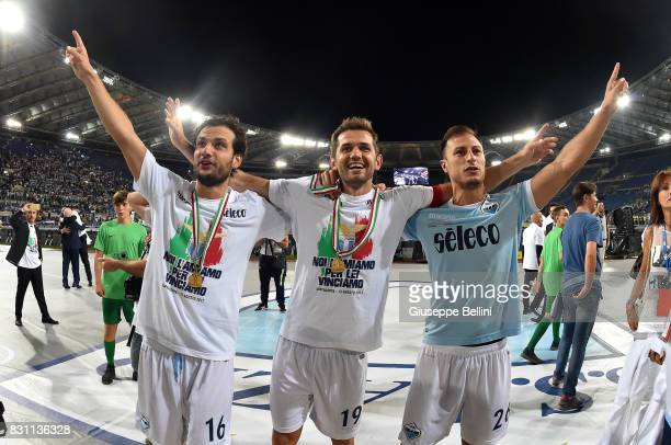 Marco ParoloSenad Lulic and Stefan Radu of SS Lazio celebrate the victory afrer the Italian Supercup match between Juventus and SS Lazio at Stadio...