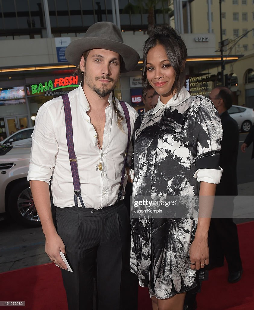 Marco Perego and actress Zoe Saldana attend the premiere of Pantelion Film's 'Cantinflas' at TCL Chinese Theatre on August 27 2014 in Hollywood...