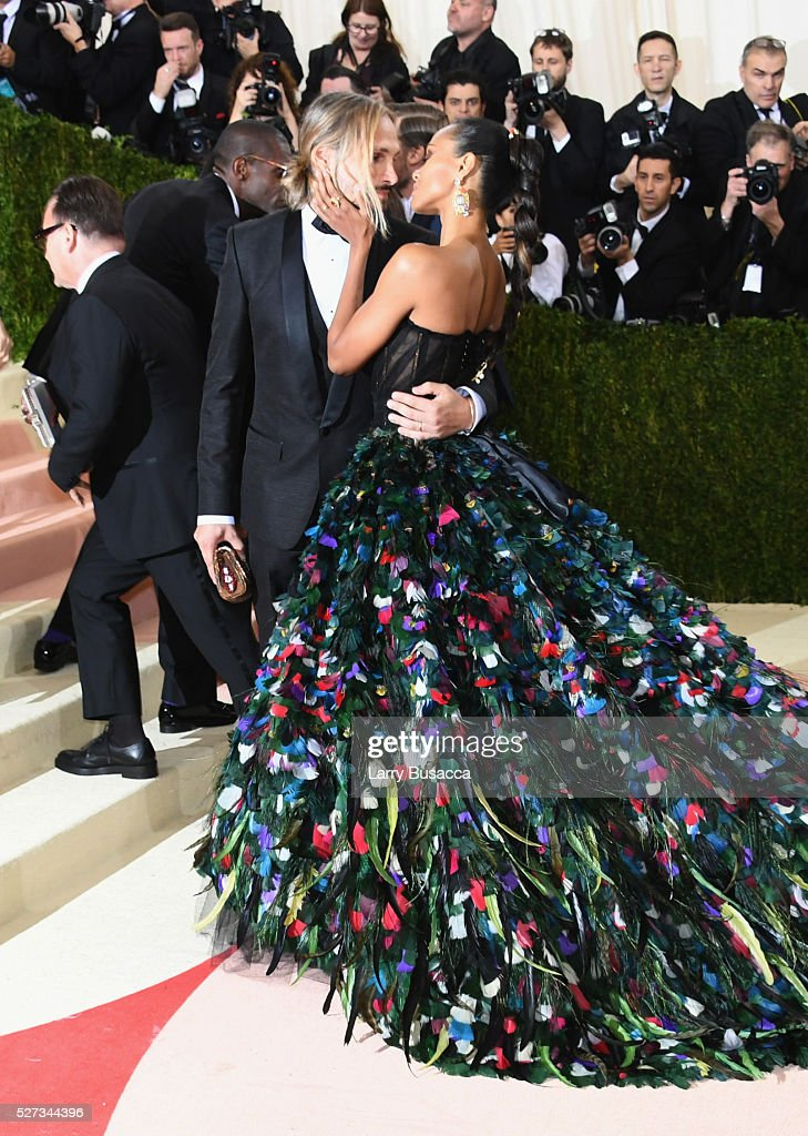 Marco Perego (L) and Zoe Saldana attend the 'Manus x Machina: Fashion In An Age Of Technology' Costume Institute Gala at Metropolitan Museum of Art on May 2, 2016 in New York City.