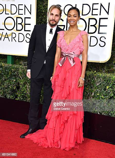 Marco Perego Zoe Saldana arrives at the 74th Annual Golden Globe Awards at The Beverly Hilton Hotel on January 8 2017 in Beverly Hills California