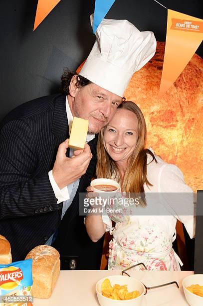 Marco Pierre White and a finalist attend the 'Walkers 'Do Us A Flavour' finalists launch at Paramount Centre Point on July 28 2014 in London England